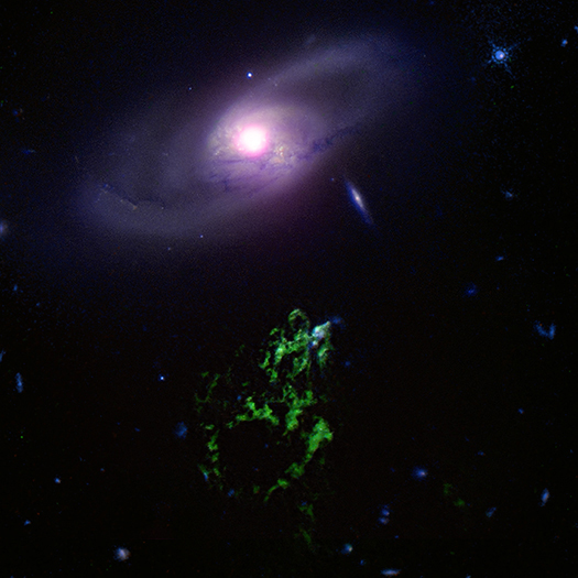 Galaxy IC 2497 above Hanny's Voorwerp. Image credit and copyright- X-ray: NASA/CXC/ETH Zurich/L.Sartori et al, Optical: NASA/STScI